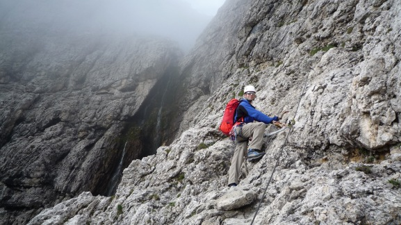 Climbing the Via Ferrata Brigata Tridentina.