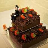 The rock climbing wedding cake toppers on the chocolate marquis.