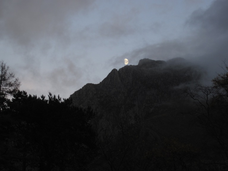 The Moon over the west face of Tryfan in Snowdonia National Park, Wales.