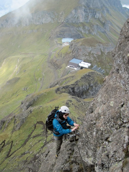 Climbing the via ferrata Via Delle Trincee in the Dolomites.