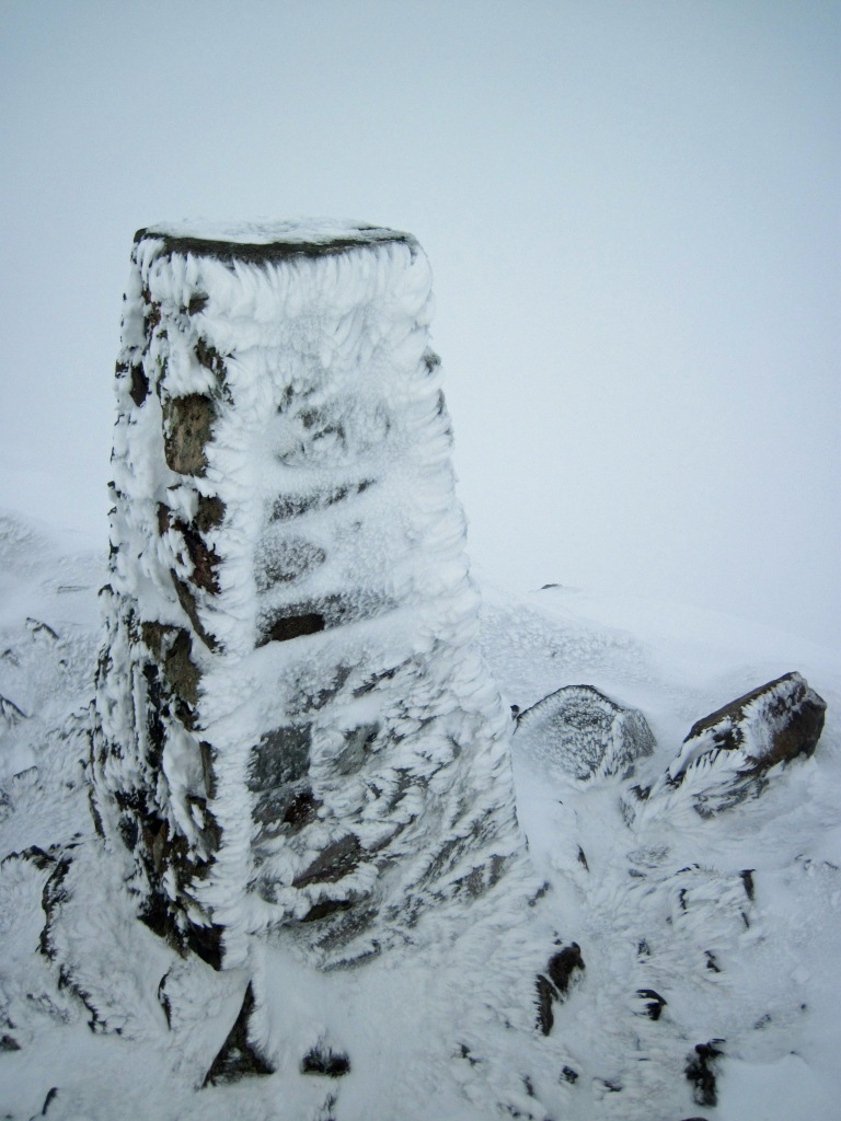 The trig point on the summit of Red Screes in the Lake District.
