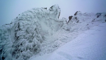 Rime on a boulder on the summit of Glyder Fawr in Snowdonia National Park, North Wales.