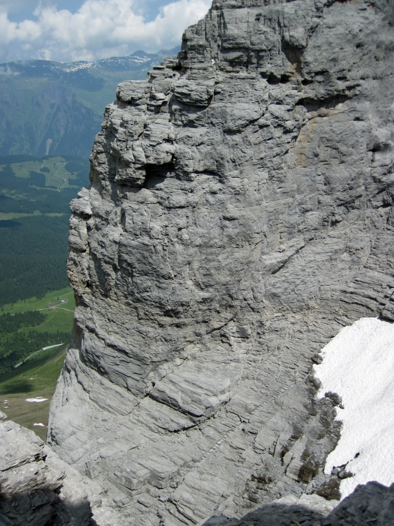 The Rotstock Via Ferrata steps are visible cutting diagonally across the Eiger and into a snow-filled scoop at the back of the gully.