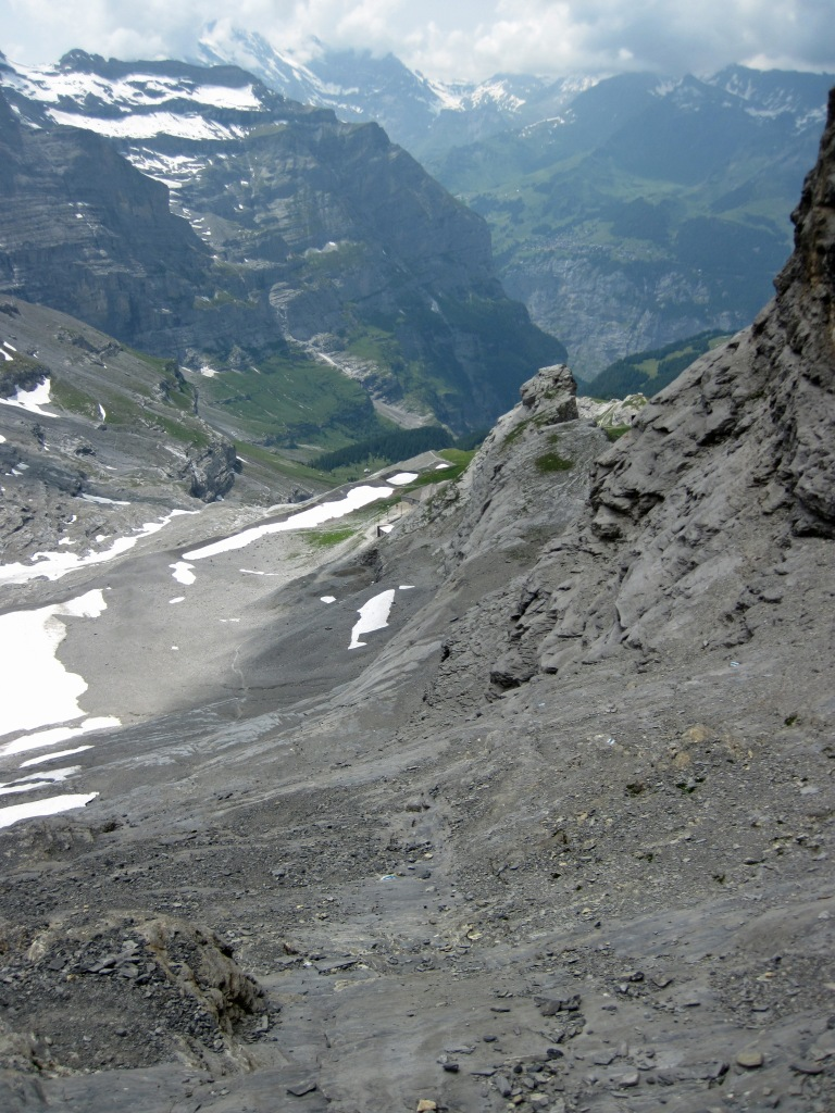 The descent route from the Rotstock, with the Eigergletscher Station in the distance.