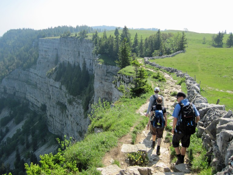 Valerie, Wanda and Marc walking along the edge of the Creux du Van.