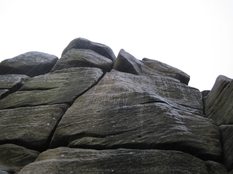 Rain trickling down Cracked Buttress at Brimham Rocks.