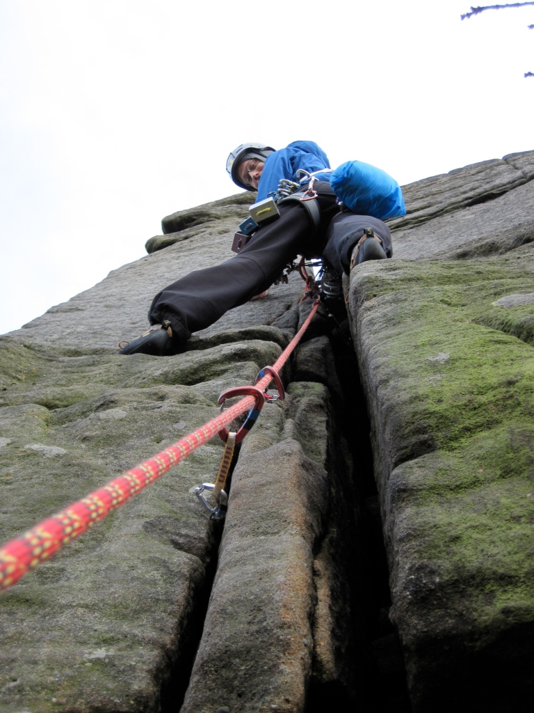 Me climbing Wobblestone Crack at Burbage in the Peak District.
