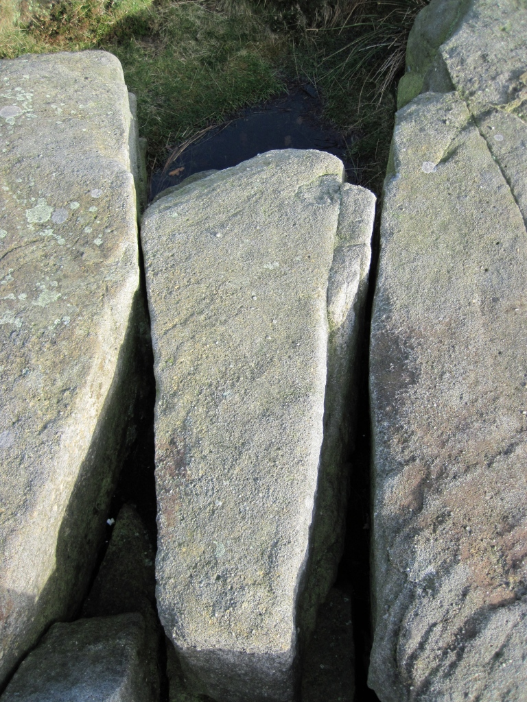 The wobbly rock that might make for some wobbly anchors at the top of Wobblestone Crack.