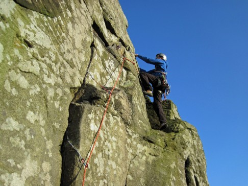 Climbing Sickle Buttress (HVD**) at Froggatt Edge on a brilliantly sunny March day.
