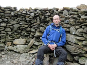 Sitting in the summit shelter on Moel Eilio in Snowdonia National Park