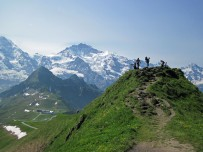 The summit of Mannlichen, with the Monch and Jungfrau behind, in Switzerland.