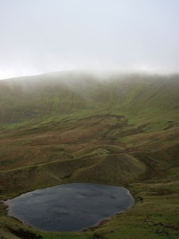 Llyn Cwm Llwch and Pen y Fan in the Brecon Beacons.
