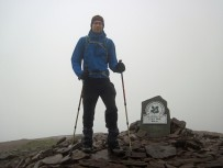 Trying hard to stay standing in strong winds on top of Pen y Fan.