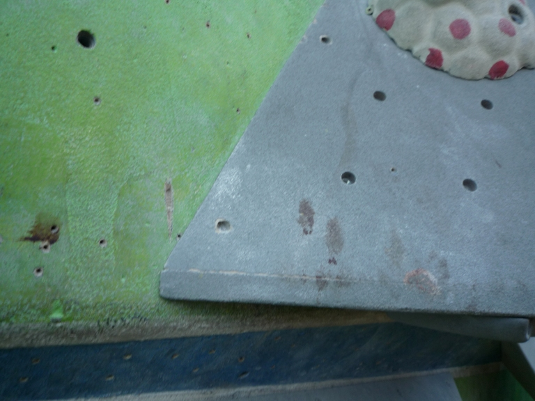 Bloody fingerprints on a climbing wall (not my fingerprints) demonstrate the damage climbers can do to themselves.