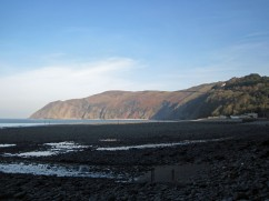 Back at Lynmouth, with the tide now out and the hill on which Countisbury sits bathed in warm, late afternoon sun.