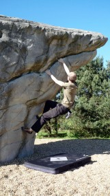 Me climbing on The Prominent Prow boulder at Fairlop Waters Boulder Park.