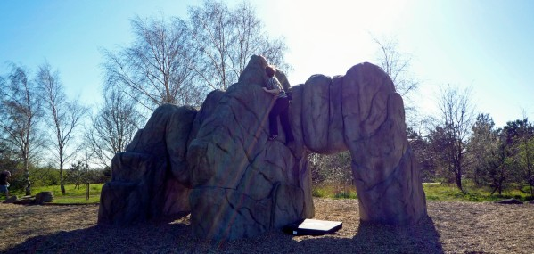 Valerie climbing on The Arches boulder at Fairlop Waters Boulder Park in London.