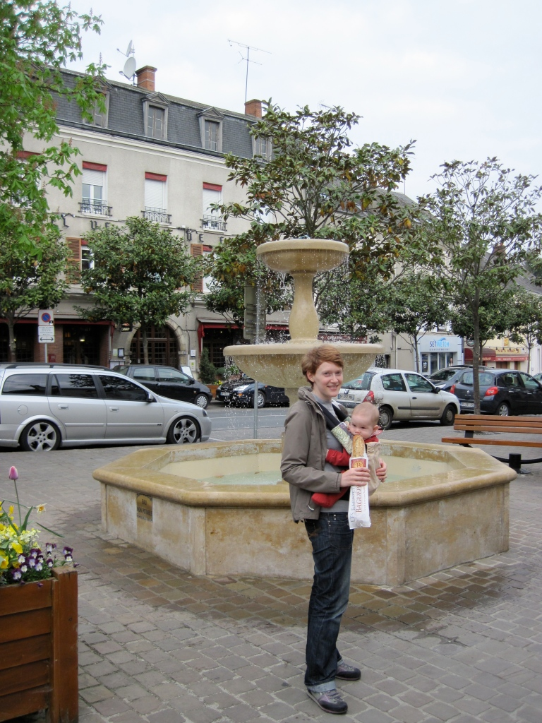 Valerie and Leo in Malesherbes, with the Hotel de l'Ecu de France behind them.