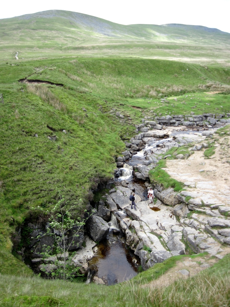 Gapping Gill and Fell Beck, with the summit of Ingleborough behind.