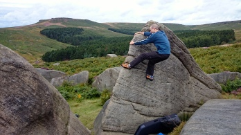 Me climbing The Crook on The Lamb boulder at Burbage South Valley.
