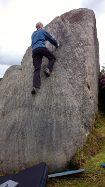 Me climbing Bog Standard Slab on The Sentry boulder at Burbage South Valley.