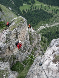 Valerie on the bridge on the Via Ferrata Sandro Pertini in the Dolomites, Italy.