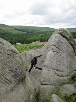 Valerie climbing Lamb Slab Left on The Lamb boulder at Burbage South Valley.