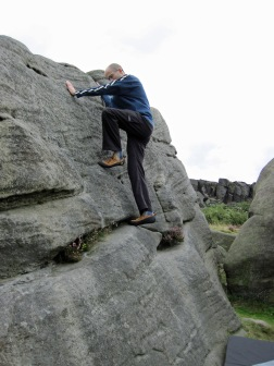 Me climbing Lamb Slab Left on The Lamb boulder at Burbage South Valley.