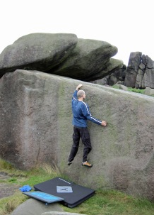 Me climbing Wall Past Flake on The Tank boulder at Burbage South Valley.