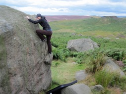 Valerie climbing Big Flakes on The Armoured Car boulder at Burbage South Valley.