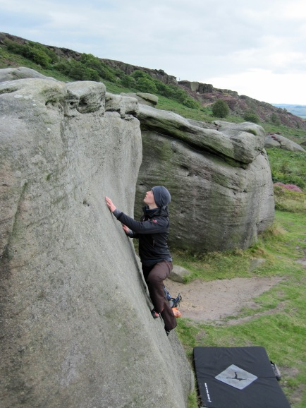 Valerie climbing The Windmill on The Briquette boulder at Burbage South Valley.