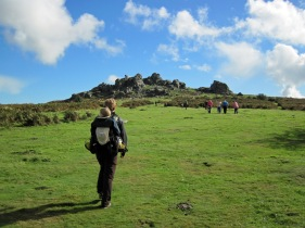 Valerie and Leo walking towards Hound Tor on Dartmoor.