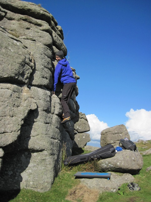 Me climbing the Groove problem on Perched Block at Hound Tor.