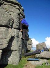 Me climbing Groove on the Perched Block at Hound Tor.