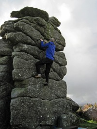 Me bouldering on Top Hat boulder at Hound Tor.