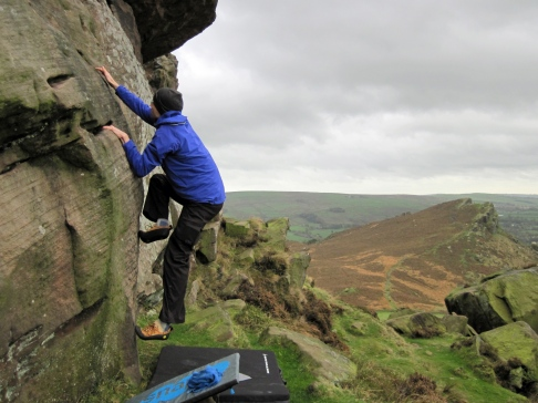 Me climbing the boulder problem Goat's Gruff on the base of The Roaches' Upper Tier.