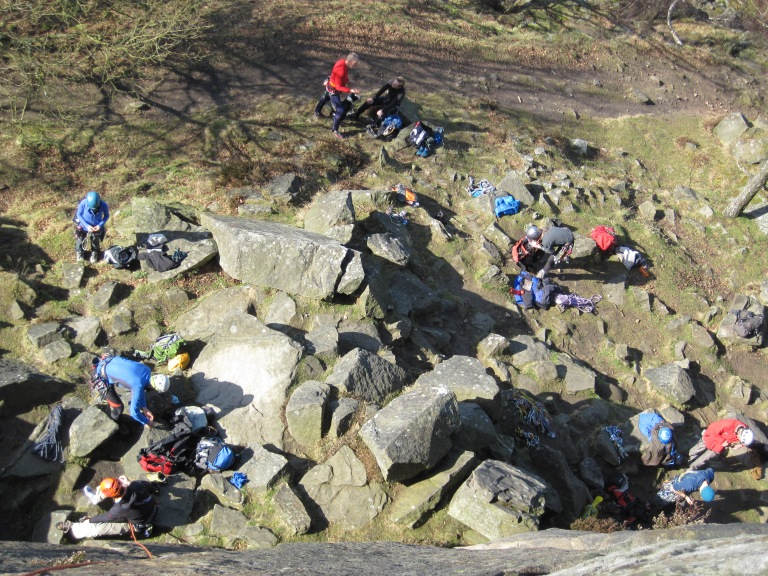 Rock climbers at the bottom of Froggatt Edge.