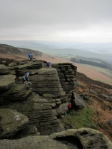 Climbing on Bamford Edge on a wet day in the Peak District.
