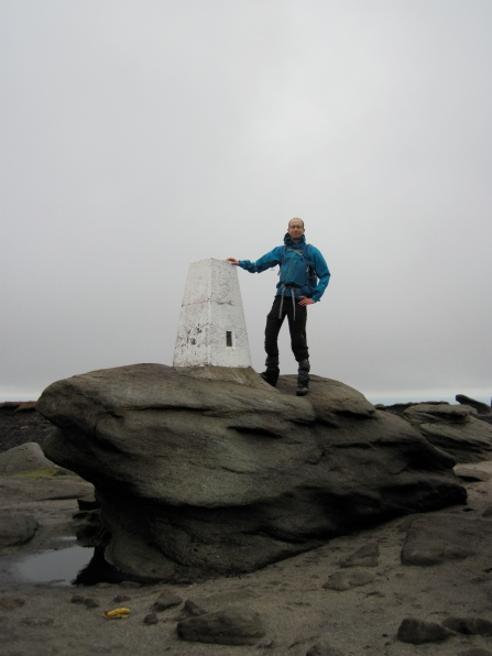 Me standing by the trig point on Kinder Low.