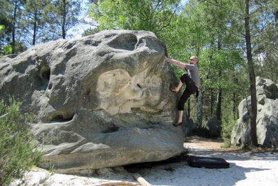 Me climbing boulder problem 26 on the yellow circuit at Rocher des Potets.
