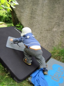 Leo enjoying playing on our bouldering mat.