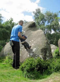 Leo enjoying climbing a boulder at Cratcliffe without using his hands.
