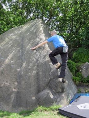 Me climbing Pink Arete (V0- 4b) at Cratcliffe.