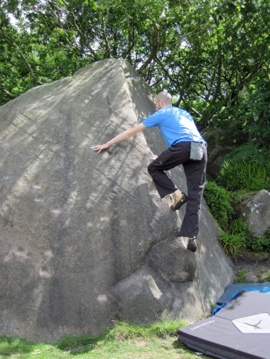 Me climbing Pink Arete (V0- 4b) at Cratcliffe.