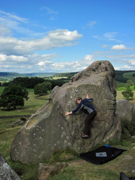 Valerie climbing JT (V0- 4b) at Robin Hood's Stride.