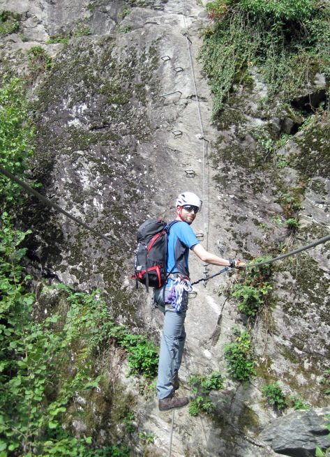 Me crossing the wire bridge on the Klettersteig Huterlaner.