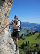 John traverses around a corner on the Klettersteig Knorren.