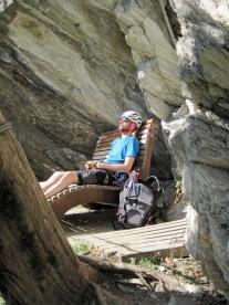 Having a brief rest under an overhang on the Klettersteig Pfeilspitzwand.