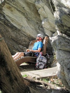 Having a brief rest under an overhang on the Klettersteig Pfeilspitzwand.