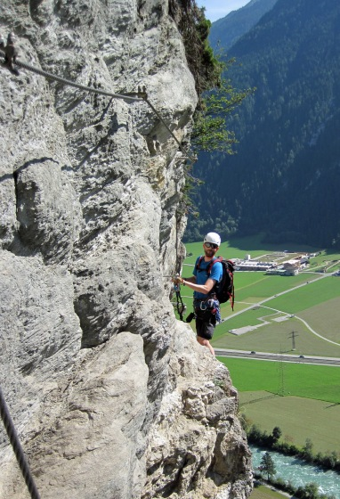 Me standing by the bell on the Klettersteig Pfeilspitzwand (the bell is just visible behind my lanyards).